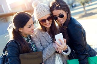 Dollarphotoclub_80210505_Three_students_girls_using_mobile_phone_in_the_campus.jpeg